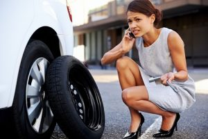 businesswoman flat tire